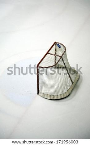 Hockey net on an ice rink - stock photo
