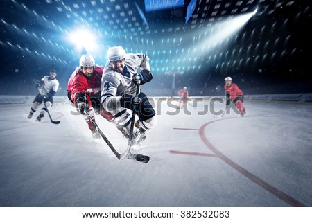 Hockey players shoots the puck and attacks - stock photo