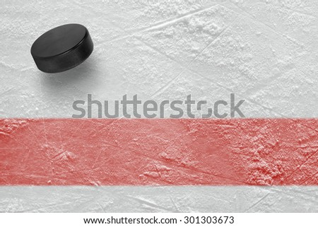 Hockey puck on the site. Texture, background - stock photo