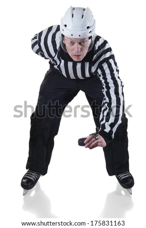 Hockey referee holding a puck in face off position. Front view. White background with shadow. - stock photo