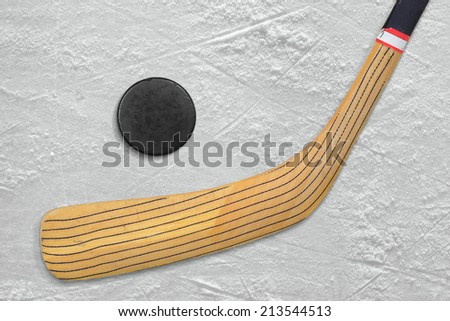 Hockey stick and puck lying on the ice. Fragment  - stock photo