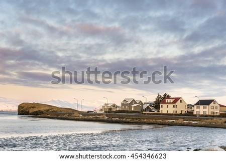 Hofn on sunrise in winter. Iceland. - stock photo