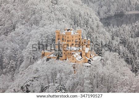 Hohenschwangau Castle in winter landscape. Germany - stock photo