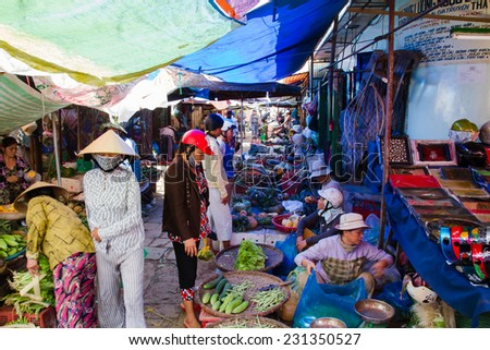 HOI AN, VIETNAM - SEP 6: People at a market in Hoi An, Vietnam on September 6, 2011. - stock photo