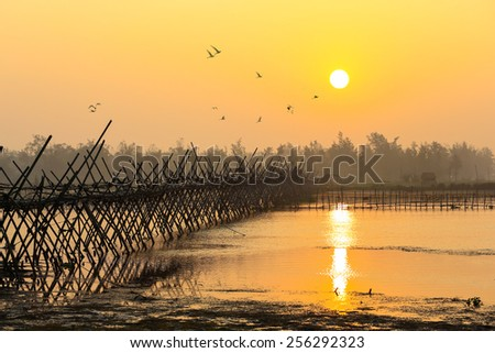 HOIAN, VIETNAM-JAN 23: Binh Giang Brdge in early morning on river at January 23, 2015 in Hoian, Vietnam. Hoian is recognized as a World Heritage Site by UNESCO. - stock photo