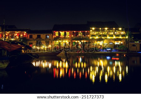 HOIAN, VIETNAM, JANUARY 23: Hoai river in ancient Hoian town at night on January 23, 2015 in Hoian, Vietnam. Hoian is recognized as a World Heritage Site by UNESCO. - stock photo