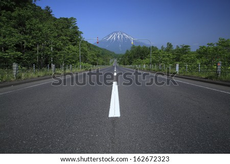 Hokkaido, the way which continues to Mt. Yotei - stock photo