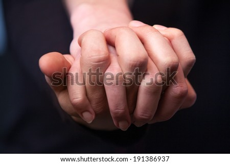 Hold my hand. Close up of young caucasian couple holding hands - stock photo