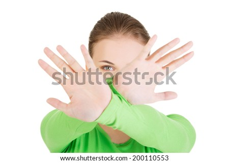 Hold on, Stop gesture showed by young woman hands - stock photo