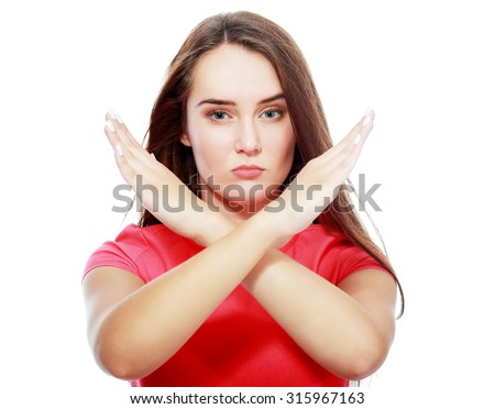 """Hold on, Stop gesture with indignation showed by young pretty woman, woman says no to the camera/viewer by showing the palm of the hand and looking away, """"talk to the hand"""" - stock photo"""