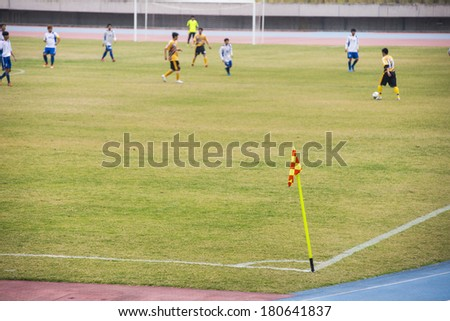 hold the stadium football game, both teams fighting hard with athletes, only one team will win the final - stock photo