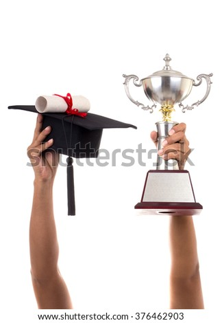 Hold the trophy honored appreciated. And caps with Diploma in education. on White background - stock photo