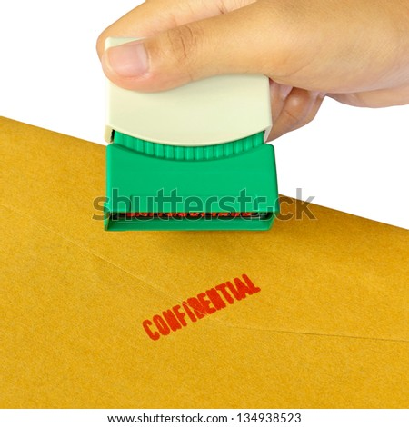 Holding a confidential stamper isolated over white background - stock photo