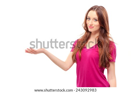 Holding a copy space. Beautiful young smiling woman holding a copy space and smiling while standing isolated on white - stock photo