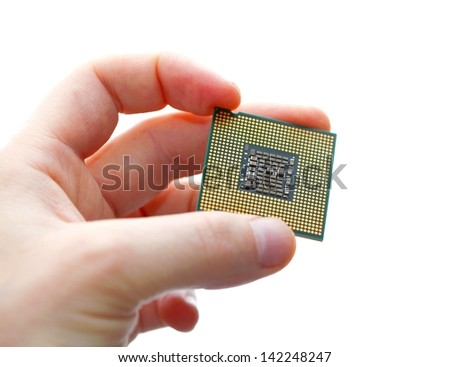Holding a CPU in hand - stock photo