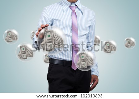 Holding a dollars in the ball in his hands. - stock photo
