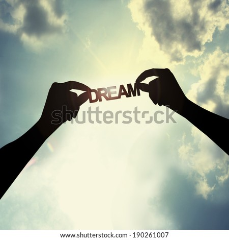 holding a dream in sky - stock photo