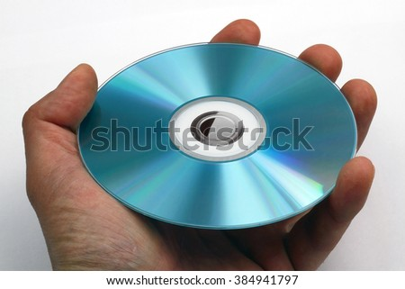 Holding a DVD or CD - stock photo