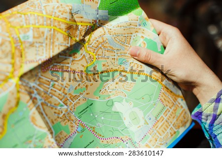 Holding a map of the city, close-up - stock photo