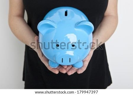 Holding a Piggy Bank - stock photo