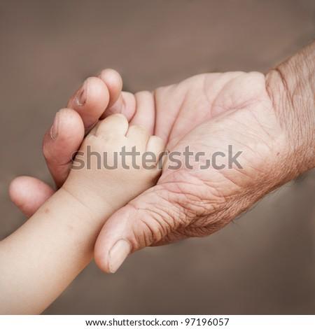 holding baby hand - stock photo
