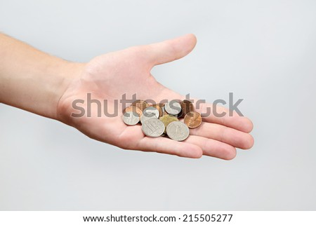 Holding Coins, US dollars coins in a flat male hand - stock photo