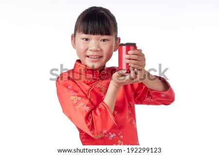 Holding drink chinese girl in traditional Chinese cheongsam, isolated on white background - stock photo