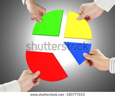Holding four pie chart pieces gray background - stock photo