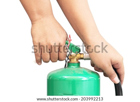 Holding green fire tank isolated on a white background - stock photo