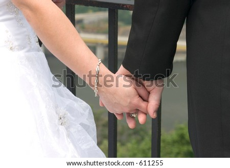 Holding hands. - stock photo
