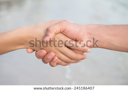 holding hands asian people on the beach - stock photo