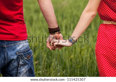 Holding hands couple - stock photo