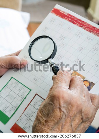 holding magnifying glass - stock photo