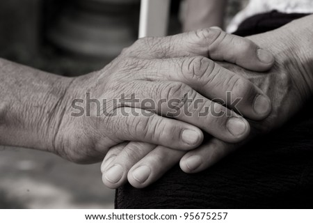 holding old hand - stock photo