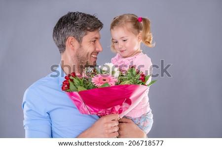 holding present gift for family member - stock photo