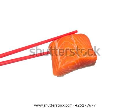holding slice raw salmon by chopsticks isolated on white background - stock photo