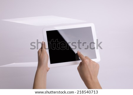 Holding tablet in hand touch - stock photo
