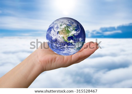 Holding the Earth, on blue background - stock photo