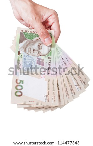 Holding ukraine money - stock photo