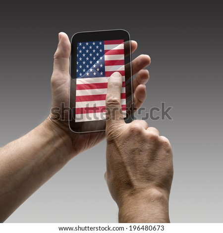 Holding USA flag screen smart phone. There is a route for hand and finger.  - stock photo