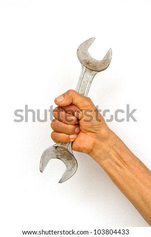 Holding wrench in hand on white background - stock photo