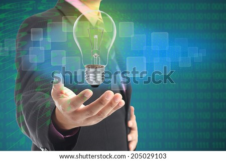 Holding your digital idea with your hand   - stock photo