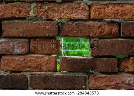 hole in brick wall/wall of bricks/hole in wall - stock photo