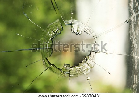 hole in glass - stock photo