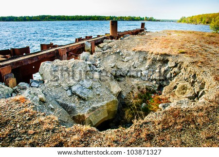 Hole in the ground made by erosion - stock photo
