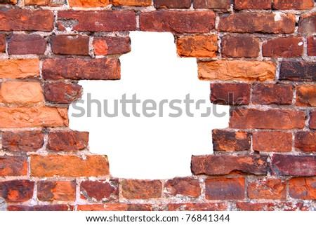 hole in the old brick wall - stock photo