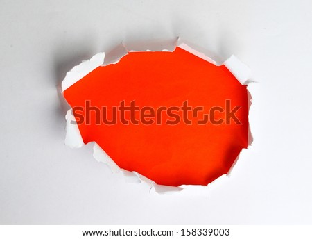 Hole in the paper - stock photo