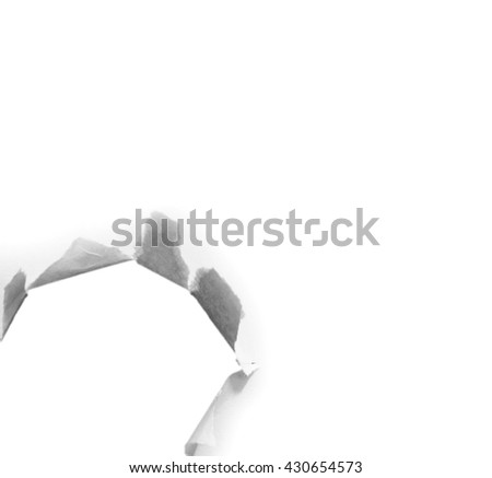 Hole in the paper on white background with clipping path. - stock photo