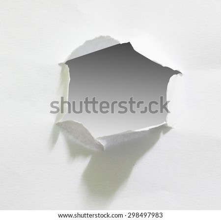 Hole in the paper sheet, clipping path. - stock photo