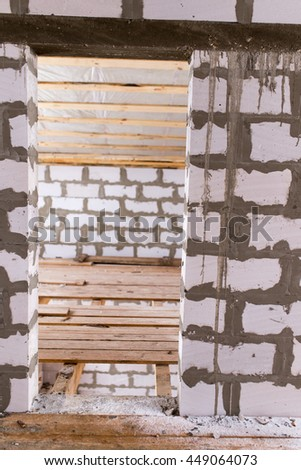 hole in the wall to the door in a new home - stock photo